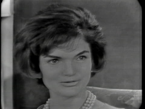"""close up of jacqueline kennedy, who has short hair, and is wearing a dress and a pearl necklace. she says: """"yes, i think it doesn't matter what else... - jackie kennedy stock videos & royalty-free footage"""