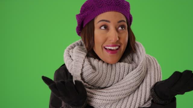 close up of joyful latina female smiling and laughing on green screen - 震える点の映像素材/bロール