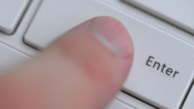 close up of keyboard, focus on enter button - enter key stock videos & royalty-free footage