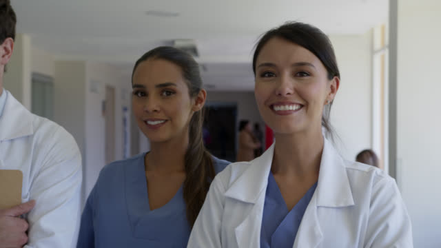 close up of latin american team of healthcare professionals at the hospital facing camera smiling - laboratory coat stock videos & royalty-free footage