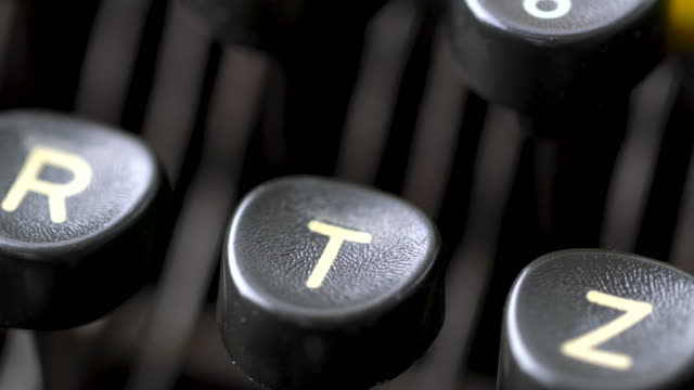 4k close up of letter in retro & vintage style typewriter in studio - the alphabet stock videos & royalty-free footage