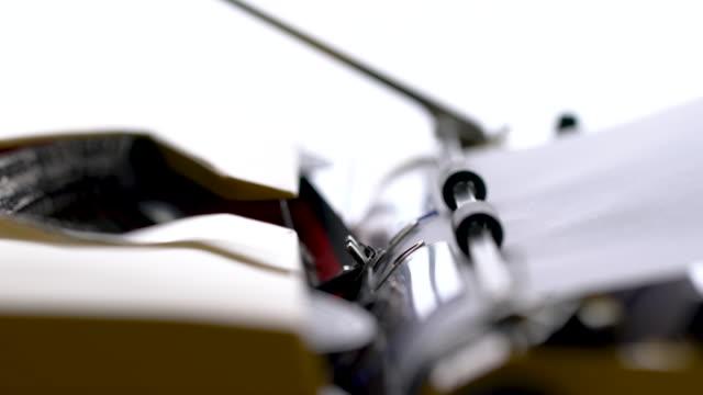 4k close up of letter in retro & vintage style typewriter in studio - typewriter stock videos & royalty-free footage