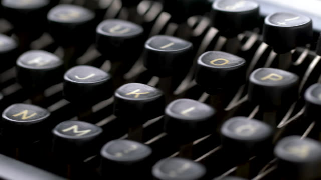 4k close up of letter in retro & vintage style typewriter in studio - author stock videos & royalty-free footage