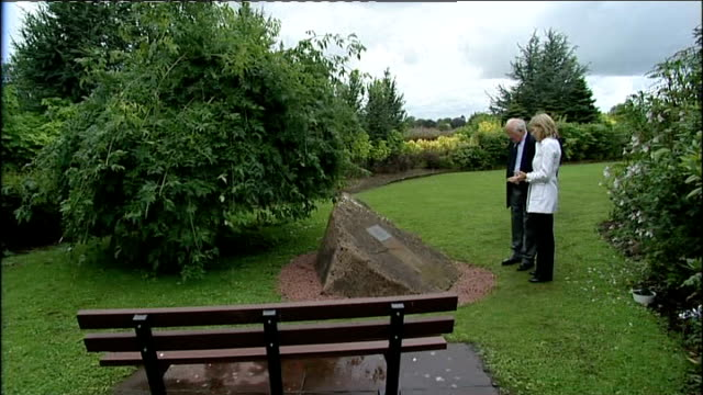 close up of lockerbie air disaster memorial plaque reporter and john gair looking at memorial maxwell kerr interview sot - memorial plaque stock videos and b-roll footage
