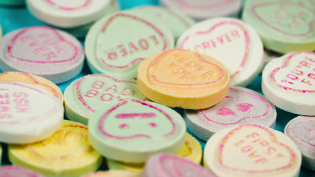 close up of love heart sweets slowly revolving - valentines day stock videos & royalty-free footage