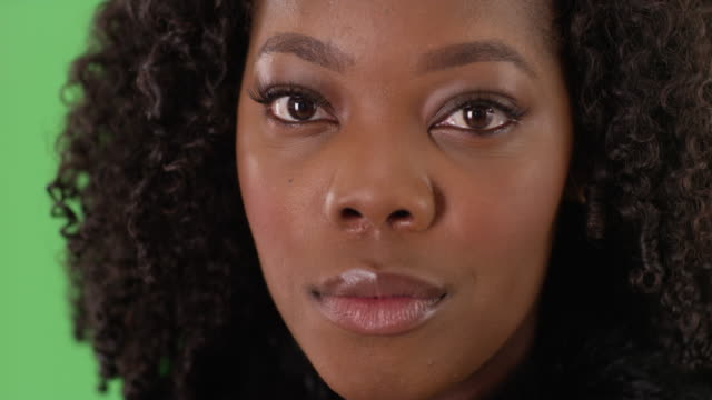 close up of lovely black female with gentle smile on green screen to be keyed - {{asset.href}} stock videos & royalty-free footage