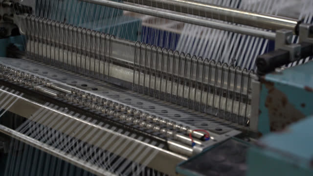 ゴム糸で動く機械のクローズアップ - 絆創膏点の映像素材/bロール