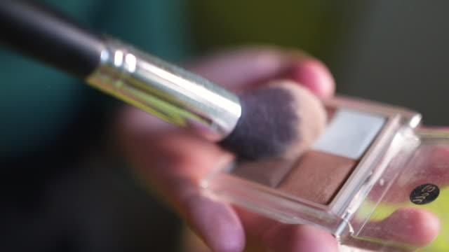 close up of makeup brush mixing - makeup artist stock videos & royalty-free footage