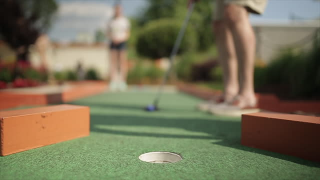 vídeos y material grabado en eventos de stock de close up of making a putt in miniature golf. - putt