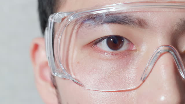 close up of male eye - lens eye stock videos & royalty-free footage