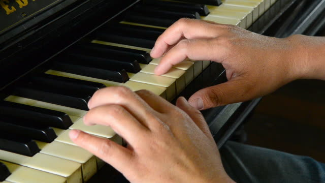 close up of male hands playing piano - musical symbol stock videos & royalty-free footage