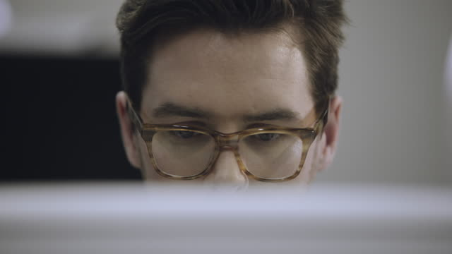 close up of male working on computer - it professional stock videos and b-roll footage