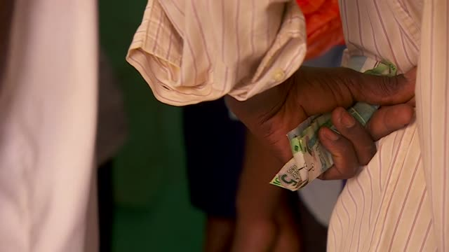 Close up of man holding banknotes in his hand in Khartoum Sudan