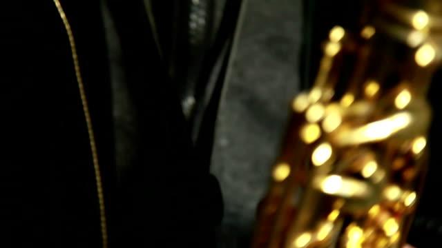 close up of man playing saxophone - saxophone stock videos & royalty-free footage