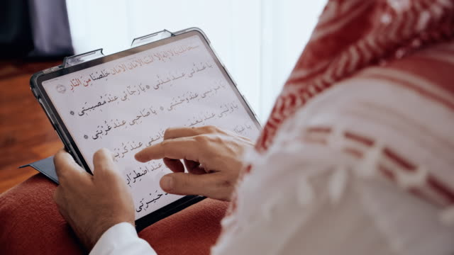 close up of man reading arab praying text using digital tablet. - middle eastern ethnicity stock videos & royalty-free footage