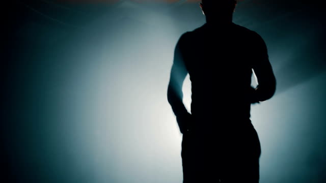 Close up of man silhouette working out