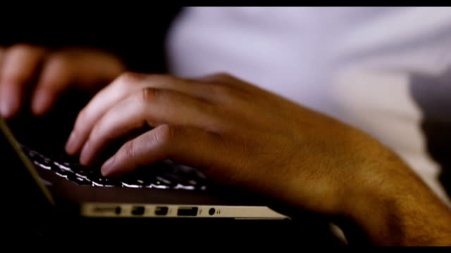 close up of man typing on keyboard - using laptop stock videos & royalty-free footage