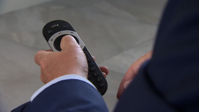 close up of man using remote control for the satellite tv skyq box - remote control stock videos & royalty-free footage
