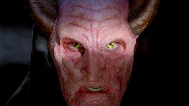 close up of man wearing devil mask / looking at camera - devil stock videos & royalty-free footage