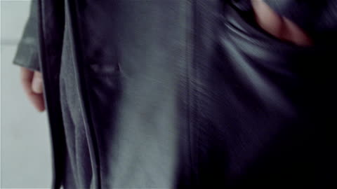 close up of man wearing leather jacket reaching into pocket and removing zippo lighter - pocket stock videos & royalty-free footage