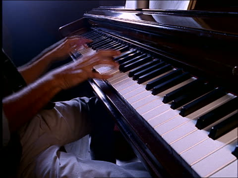 close up of man's hands playing piano - jazz video stock e b–roll
