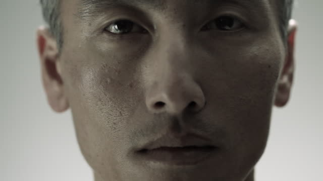 close up of mature chinese man - staring stock videos & royalty-free footage