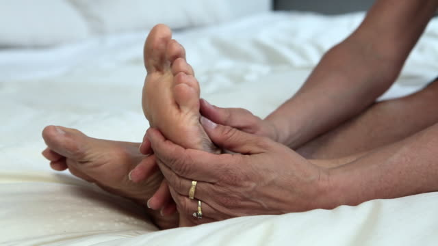 close up of mature woman massaging feet - rubbing stock videos & royalty-free footage