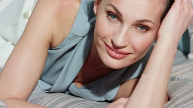 close up of mature woman relaxing on a bed. - 50 54 years stock videos & royalty-free footage