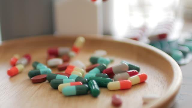 Close up of Medicine Prescription Bottles & Pills , Medical Concept , Dolly shot