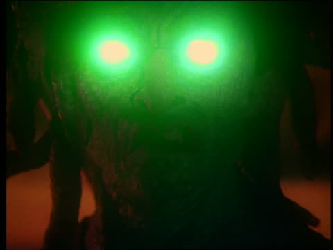 close up of medusa with glowing green eyes - greek mythology stock videos and b-roll footage