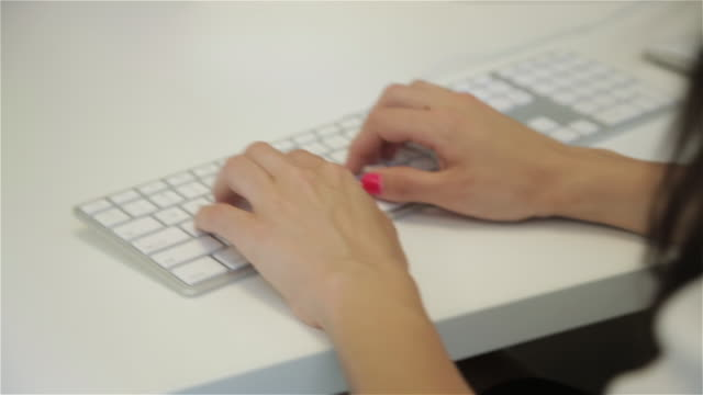 close up of middle eastern female executive typing on computer - nail varnish stock videos and b-roll footage