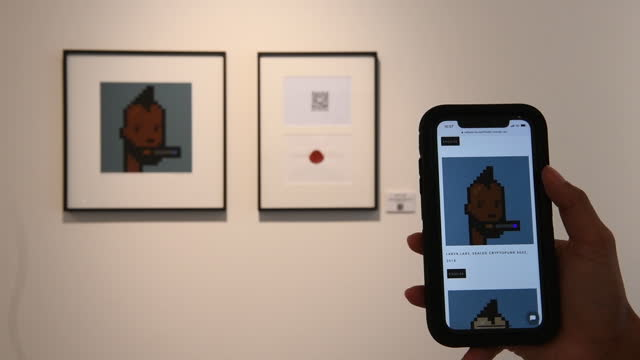 close up of mobile app on smart phone in front of nft art works for sale , exhibited at hofa gallery, in city od westminster, london, england, u.k.,... - scrolling stock videos & royalty-free footage