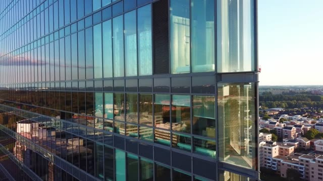 close up of modern glass and steel building - svezia video stock e b–roll