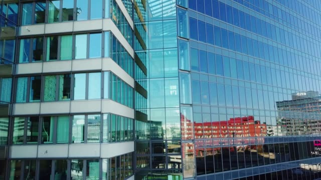 close up of modern glass and steel building - building exterior stock videos & royalty-free footage