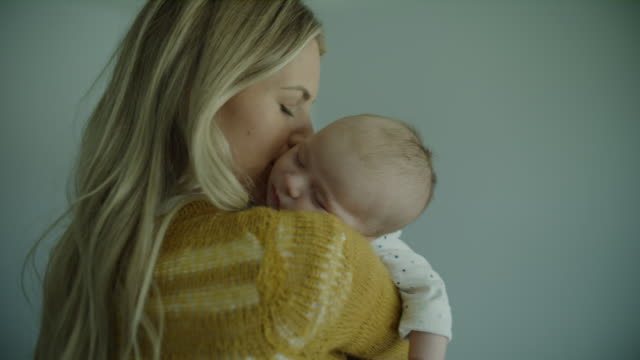 close up of mother hugging and kissing sleeping baby son / lehi, utah, united states - single mother stock videos & royalty-free footage