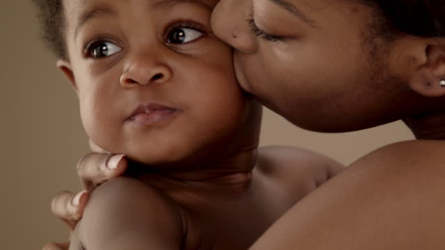 close up of mother kissing baby girl (13-14 months) - curly stock videos & royalty-free footage
