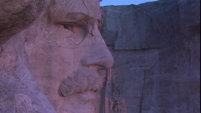 a close up of mount rushmore focuses on the faces of u.s. presidents roosevelt and lincoln. - mt rushmore national monument stock videos & royalty-free footage