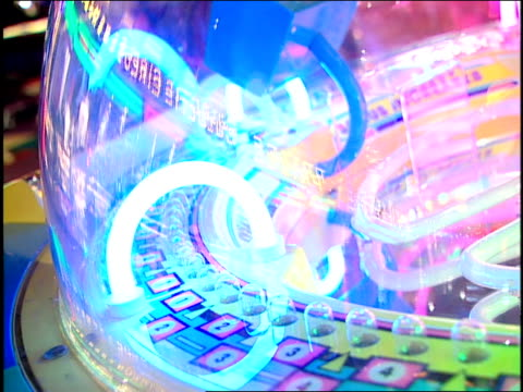 Close Up of Moving Brightly Colored Lights in an Arcade Game