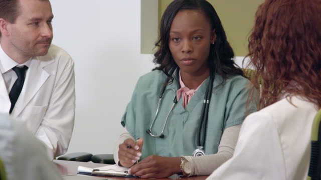close up of multi-ethnic medical team meeting - administrator stock videos and b-roll footage