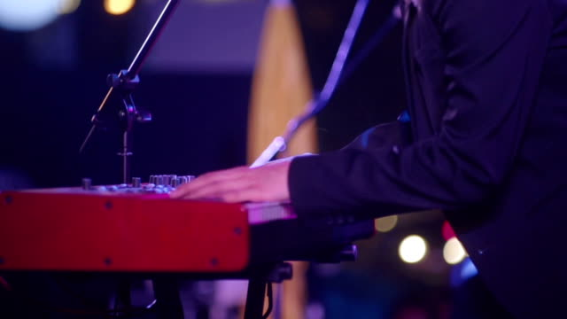 close up of musician hand playing paino