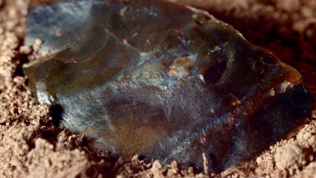 Close up of native american broken hand axe ax jasper chert paiute indian stone tool in dirt from Oregon great basin desert
