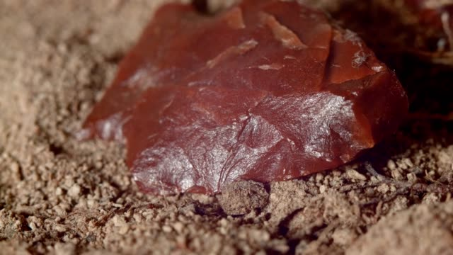 close up of native american red arrowhead jasper chert paiute indian stone tool in dirt from oregon great basin desert - indian arrowhead stock videos and b-roll footage