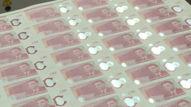 close up of new sheet of plastic polymer fifty pound banknotes featuring alan turing - alan turing stock videos & royalty-free footage
