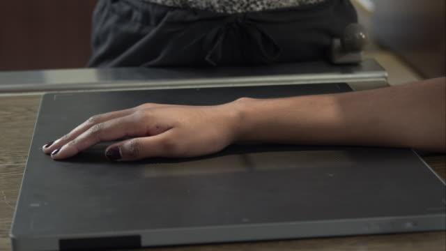 close up of nurse preparing young woman for arm scan. - menschliche gliedmaßen stock-videos und b-roll-filmmaterial