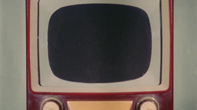 close up of old red + white television with blank screen - antique stock videos & royalty-free footage