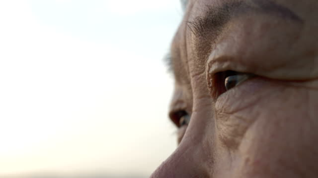 close up of older woman's eye looking - joy stock videos & royalty-free footage