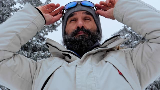 close up of one middle-aged man enjoying the winter mountain, portrait, winter sport, travel, exploration, adventure, tourism, mountain climbing, determination, athlete, ladder of success, outdoors - ladder of success stock videos & royalty-free footage
