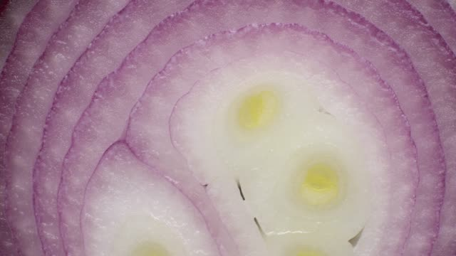 close up of onion texture skin rotate. - slice stock videos & royalty-free footage