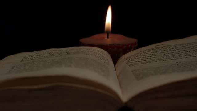 close up of open book surrounded by candlelight - candlelight stock videos & royalty-free footage