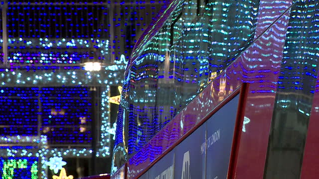 close up of oxford street christmas lights and london bus - virus organism stock videos & royalty-free footage